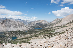 Lakes and Pine Forest in the Sierra Nevada Mountains. A panoramic view of Kings Canyon National Park looking down from Kearsarge Pass royalty free stock images
