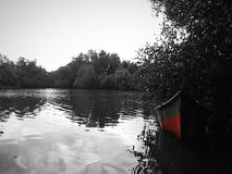 Lakes and red boat Stock Image