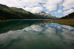 Lakes reflections. Lake in Switzerland reflecting mountains stock photography