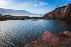 Lakes and Rock. Landscape of deep Lake covered with rocky terrain Royalty Free Stock Image
