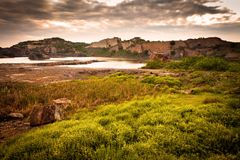 Lakes and Rock. Landscape of deep Lake covered with rocky terrain Stock Photo