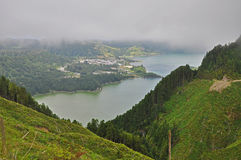 Lakes Sete Cidades in the fog. Two lakes Sete Cidades in a beautiful valley in the fog on the Sao Miguel island Azores Royalty Free Stock Images