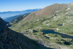 Lakes in valley in Pyrenees mountains Stock Photos