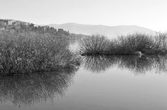 Lakescape in bw. Peaceful lakescape in black and white. The was taken in Kastoria lake, Greece Stock Photo