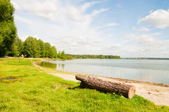 Lakeshore grassy banks Royalty Free Stock Images