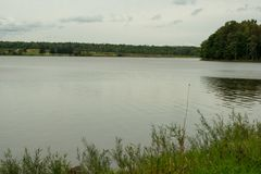 Lakeshore of Howard Eaton reservoir in Northwestern Pennsylvania. In late summer. Grey sky in the background stock images