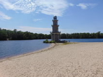 Lakeshore Lighthouse. In summer with vivid sky Stock Photo