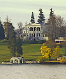 Lakeshore mansion. Scene of a lakeshore mansion in skaneatles,ny Royalty Free Stock Images
