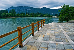 Lakeshore near a mountain on cloudy day Royalty Free Stock Images