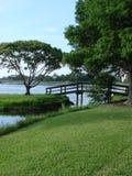 Lakeside. The view of a bridge next to a lake Stock Photos