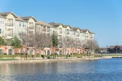 Lakeside apartment building complex with blue sky in America Royalty Free Stock Photo