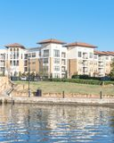 Lakeside apartment building complex with blue sky in America Stock Photography