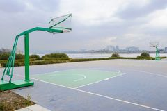 Lakeside basketball field in cloudy winter afternoon. At Tianfu New Area,Chengdu,China royalty free stock image