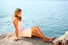 Lakeside beauty 2. Beautiful youn woman on a lake stock photo