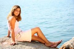 Lakeside beauty. Beautiful youn woman on a lake royalty free stock image