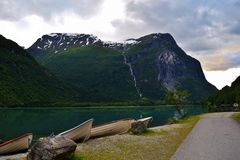 Lakeside with boats. Beautiful sunset between two mountains, near Loen, Norway. 2015 Royalty Free Stock Photos