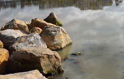 Lakeside boulders Royalty Free Stock Photo