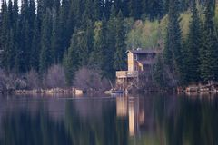 Lakeside cabin. Perfect spot to spend weekend. Cabin on a lake in calm evening Stock Photography