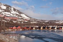 Lakeside cabins with mountain backdrop. Lappland Sweden Royalty Free Stock Photography