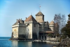 Lakeside Castle. A medieval castle on a lakeside showing the parapets, towers and castle defenses. Horizontal shot Royalty Free Stock Photo