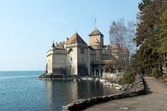 Lakeside Castle. A medieval castle on a lakeside showing the parapets, towers and castle defenses. Horizontal shot Stock Photography