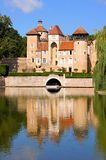 Lakeside castle with reflections, Burgundy, France Stock Image