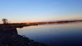 Lakeside Causeway With Water Flowing Into Lake in the Morning.  Calm Shore Water Flow Under Bridge into Body of Water. At Dawn stock footage
