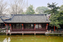 Lakeside Chinese ancient gallery in spring afternoon Royalty Free Stock Images