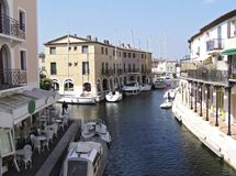 Lakeside city 2. Canal of Port Grimaud - 12 km of piers lined with cafes and  villas where fishing  boats are anchoring - also called Venice of the French Stock Photo