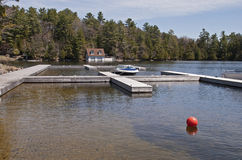 Lakeside docking for pleasure craft. In Muskoka, Ontario, Canada Royalty Free Stock Photo