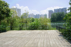 Lakeside fenced viewing platform in city of sunny summer Stock Photos
