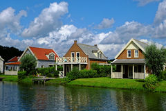 Lakeside holiday homes idyll by noon. Dutch holiday homes with porches situated at a lake.  Peaceful idyll in summer Stock Photography