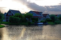 Lakeside holiday resort morning idyll. Dutch holiday homes with porches situated at a lake. Morning idyll in summer by a gentle breeze Stock Images