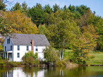 Lakeside Home Fall Foliage Royalty Free Stock Photography