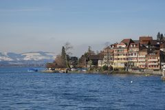 Lakeside homes seen from a cruise boat at Lake Thun, Switzerland, Europe. Winter 2017 Royalty Free Stock Images