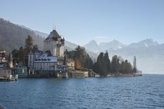 Lakeside homes seen from a cruise boat at Lake Thun, Switzerland, Europe. Winter 2017 Royalty Free Stock Image