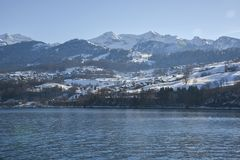 Lakeside homes seen from a cruise boat at Lake Thun, Switzerland, Europe. Winter 2017 Stock Image