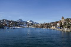 Lakeside homes seen from a cruise boat at Lake Thun, Switzerland, Europe. Winter 2017 Royalty Free Stock Photo