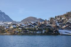 Lakeside homes seen from a cruise boat at Lake Thun, Switzerland, Europe. Winter 2017 Royalty Free Stock Photography