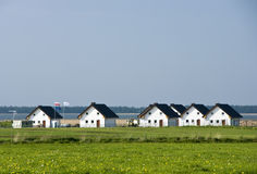 Lakeside houses. Scenic view of row of lakeside houses Stock Image