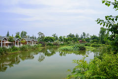 Lakeside inns at sunny summer noon. Waterside inns at sunny summer noon,Pi county,Chengdu,China stock photos