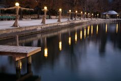 Lakeside lamps. In a row at dusk Stock Image