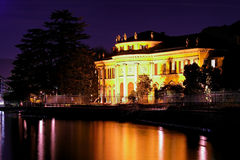 Lakeside mansion at night. Lakeside mansion with tree at night Stock Photos
