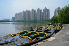 Lakeside moored boats in modern city Royalty Free Stock Photos