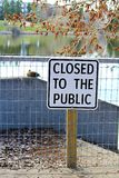 A lakeside path with a closed to the public sign Stock Photography