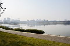 Lakeside path in green lawn on sunny winter afternoon. Chengdu,China royalty free stock images