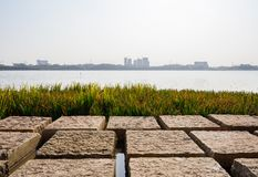 Lakeside path made of square pillar stone in sunny winter afternoon. Chengdu,China stock photos