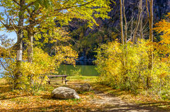 Lakeside Picnic Table among Autumnal Trees Stock Photography