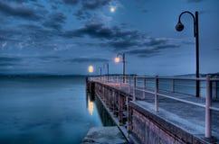 Lakeside pier before sunrise Stock Images