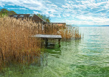 Lakeside with pontoon panorama. Beautiful panoramic view with cloudy sky over the  Lake Starnberg near Munich, Bavaria, Germany Royalty Free Stock Photography